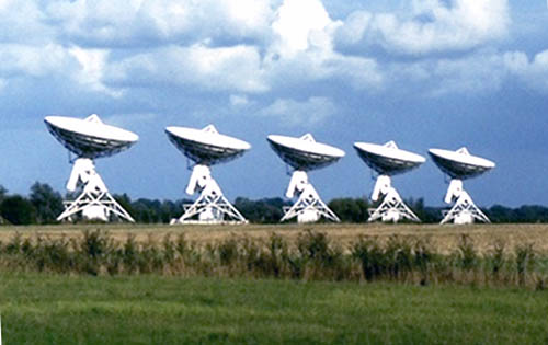 Radio telescopes by the Barton Road, built on a disused railway line